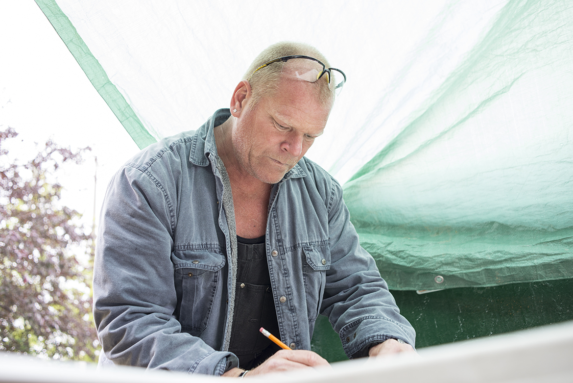 Mike Holmes drawing out a permit