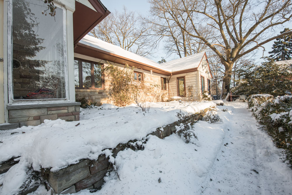 10 tasks for your winter home maintenance checklist - mike holmes - mike holmes - snowy walkway