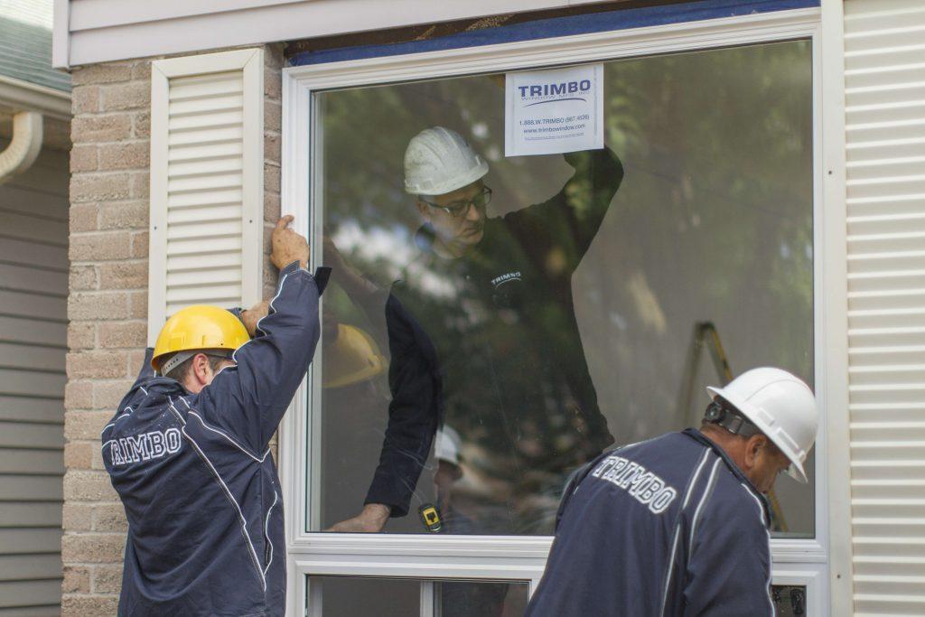 Men installing window