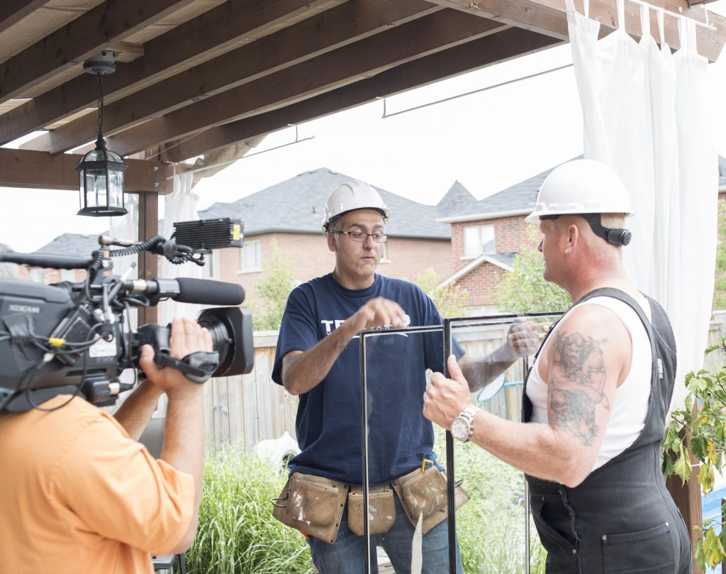 Mike Holmes and Dominic discuss double pane windows on set.