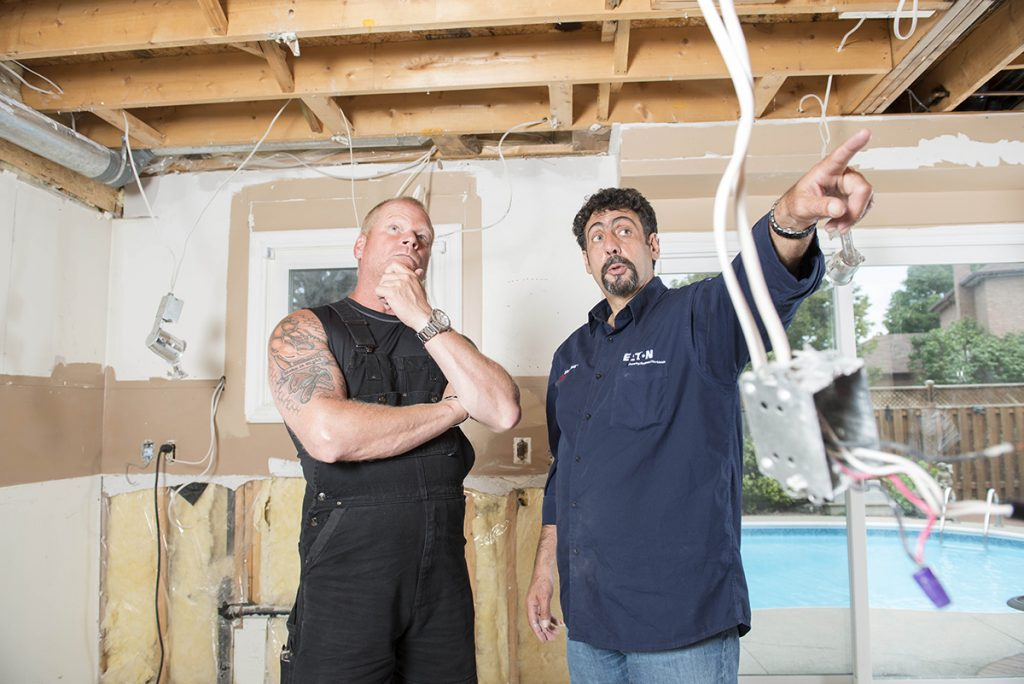 Image of Mike Holmes and Frank Cozzolino, Licensed Electrical Contractor.